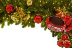 A festão do Natal das bolas e os ramos do abeto vermelho, para um quadro, podem ser usados como um molde para um quadro ou um cum fotografia de stock royalty free