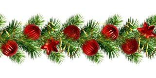 Festão do Natal dos galhos do pinheiro e das bolas vermelhas Fotografia de Stock Royalty Free