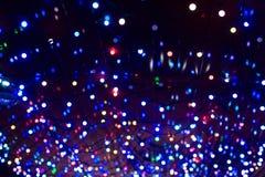 A festão do Natal ilumina o fundo Imagens de Stock Royalty Free