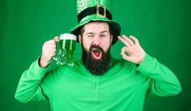Fest and holiday menu. Dyed green traditional beer. Patricks day party. Alcohol beverage. Symbol of Ireland. Man bearded. Hipster drink beer. Irish pub. Highly stock photography