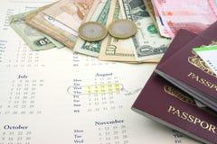Festa con soldi ed i passaporti Fotografia Stock Libera da Diritti
