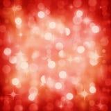A festa de Natal vermelha Sparkling ilumina o fundo Imagens de Stock