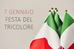 Festa del tricolore, the day of the italian flag. Some flags of italy and the text 7 gennaio festa del tricolore, january 7th tricolor day in italian, the day of Royalty Free Stock Photo