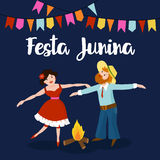 Festa junina. Boy and Girl dancing around fire at Brazilian june party. Festa junina. Brazilian june party. Boy and Girl dancing around fire at Brazilian june Royalty Free Stock Image