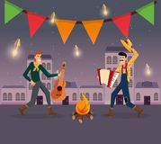 Festa Junina design. With cartoon men dancing traditional dance around a bonfire over town background vector illustration Royalty Free Stock Images