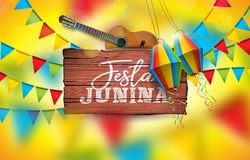 Festa Junina Illustration with Acoustic Guitar, Party Flags and Paper Lantern on Yellow Background. Typography on. Vintage Wood Table. Vector Brazil June Royalty Free Stock Photo