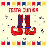 Festa Junina - June Festival, National Brazilian holiday. Red clown shoes and flags, Celebration background Royalty Free Stock Photo