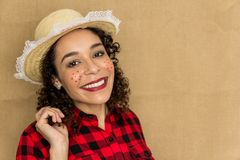 Festa Junina is June party in Brazil. Pretty woman is having a big smile and looking at the camera. She wears red and black plaid stock photos