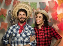 Festa Junina: party in Brazil. Man and woman dressing checked pattern clothes. Man and woman dressing checked pattern clothes are stock images