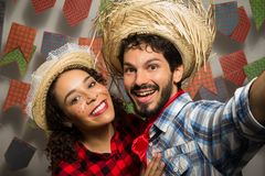 Festa Junina: party in Brazil. Man and woman dressing checked pa. Festa Junina: party in Brazil in the month of june. Man and women dressing checked pattern stock images