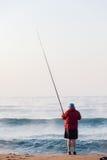 Feste della spiaggia di Surf Waves Sunrise del pescatore fotografia stock