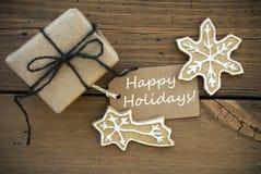 Feste felici bianche su un'insegna con la decorazione di Natale fotografia stock