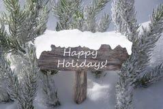 Feste felici del testo del ramo di albero dell'abete della neve del segno di Natale Fotografia Stock