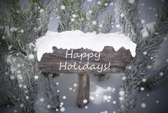 Feste felici del testo dell'albero di abete dei fiocchi di neve del segno di Natale Fotografia Stock