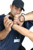 Festgehalten und mit Handschellen gefesselt Lizenzfreie Stockfotos
