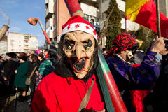 Festival ancestral customs and traditions. A masked man at Festival ancestral customs and traditions from Comanesti, Bacau, 30 december 2011 Stock Photo