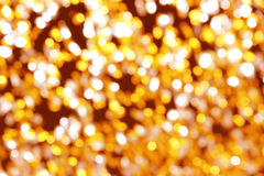 festival background with gold and silver sequins that lie on the pavement the road bokeh. Stock Photo