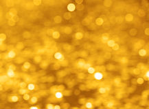 festival background with gold and silver sequins that lie on the pavement the road bokeh. Stock Photos