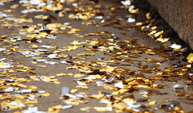 festival background with gold and silver sequins that lie on the pavement the road bokeh. Royalty Free Stock Images