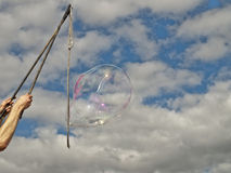 Festival bubble blowing against sky Royalty Free Stock Photography