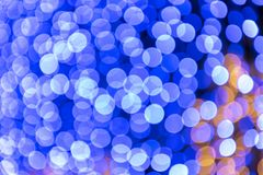 Festival or carnival abstract background with bokeh defocused lights and stars. Festival or carnival abstract background with blue bokeh defocused lights and stock photos