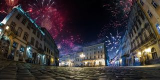 Festival celebration City background with Fireworks. Empty night plaza, old architecture. stock photos