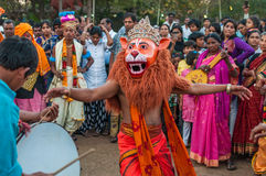 Festival celebrations in India. People with a lion make up performs in the crowd during Sankranti celebrations at Shilparamam, Hyderabad Royalty Free Stock Photos