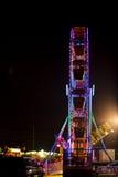 Festival colorido Ferris Wheel do 4 de julho na noite Imagem de Stock