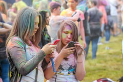 Festival of Colors in Krakow. Unidentified people dancing and celebrating during the color throw Stock Photo