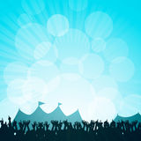 Festival and crowd. Crowd paryting in front of festival tents against a glowing blue sky Royalty Free Stock Photos