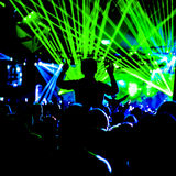 Festival Crowd Girl With Hands Up Lazers Royalty Free Stock Image
