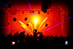 Festival Crowd Silhouette Confetti Explosion. Confetti explosion at Creamfields Festival - Crowd Silhouette hands up Stock Photos