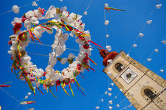 Festival Decoration And Church Tower Stock Photos