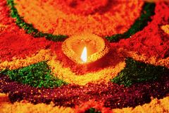 Rangoli with glowing diya. Festival of diwali celebrated with oil lamps and rangoli Royalty Free Stock Images