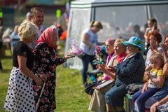 During festival events dedicated to 69th anniversary of urban-type settlement Nikolskiy formation on the river Svir Stock Photos