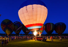 Festival för ballong för varm luft för aftonglöd royaltyfri bild