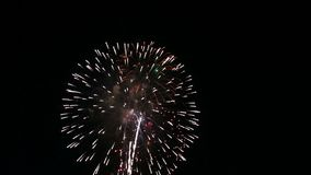 Festival fireworks burst in midair stock footage