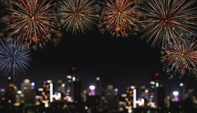 Festival fireworks at night in the city, blurred defocus Bokeh lights of building at night. For Holiday festival, New years and ce Stock Photography