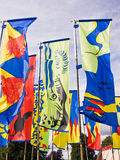 Festival Flags. In a variety of bright colours outside at a folk festival. Shrewsbury, England Stock Image
