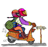 Festival goer. Colourful couple on way to festivals by moped Royalty Free Stock Photo