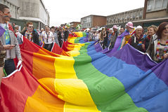 Festival goers hold the rainbow banner Stock Image