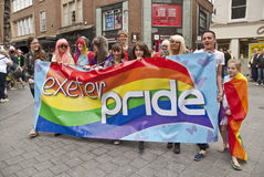 Festival goers hold up the Exeter Pride banner Royalty Free Stock Photo