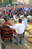 Festival of the grape harvest in Chusclan village, south of Fran. CHUSCLAN, FRANCE – October13, 2013: Traditional Wine Pressing using a manual grape crushing Royalty Free Stock Images