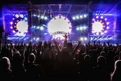 Festival huge crowd dancing with stage lights Royalty Free Stock Photography