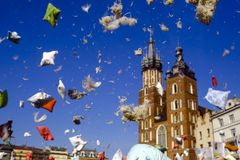 Festival image of pillows in the sky. In front of Krakow old town, after pillows battle stock images