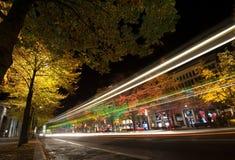 FESTIVAL OF LIGHTS 2010 in Berlin, Germany. BERLIN, GERMANY - OCTOBER 17: night traffic on Unter den Linden street lit by lights during FESTIVAL OF LIGHTS 2010 royalty free stock image