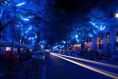 FESTIVAL OF LIGHTS 2010 in Berlin, Germany. BERLIN, GERMANY - OCTOBER 17: One of Berlin streets near Potsdamer square lit by blue lights during FESTIVAL OF royalty free stock images