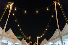 Festival Lights Decorated Over Market Booths.  Royalty Free Stock Photography