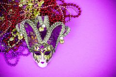 Festival Mardi Gras mask and multicolored beads on bright background. Studio Photo royalty free stock photos