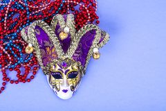 Festival Mardi Gras mask and multicolored beads on bright background. Studio Photo royalty free stock images
